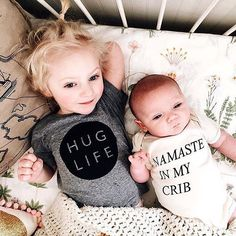 The 'Hug Life' tee keeping our organic cotton 'Namaste In My Crib' onsie company via @alovelybean