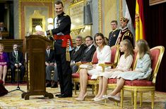 In awe: Felipe and Letizia grinned at their daughters eight-year-old Leonor, left, and seven year old Sofia .