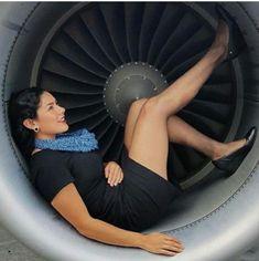 Flight attendant hot legs boobs