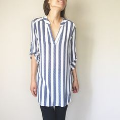 Stripe tunic top A must have this season . Stripe loose fit High low Top .Resort collection.boyfriend collarless shirt. 100%rayon Tops Tunics