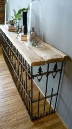 salvaged wood wrought iron fence = console table