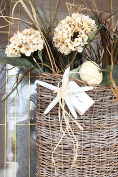 instead of a wreath, a wicker welcome backet... change flowers for the season!