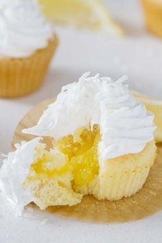 Bring in a little bit of sunshine with these Lemon Sunshine Cupcakes! Based on an old favorite cake, these cupcakes are filled with lemon curd and topped with a dreamy fluffy frosting. A sprinkling of coconut tops them off.: