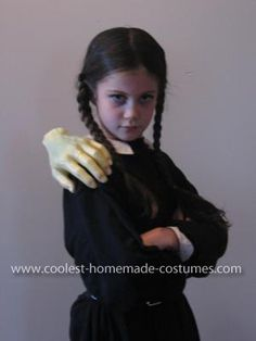 Homemade Wednesday Addams and Thing Costume: This Homemade Wednesday Addams and Thing Costume was my daughter's idea. She has always had a 'dark' sense of humour! My mother made a simple pilgrim