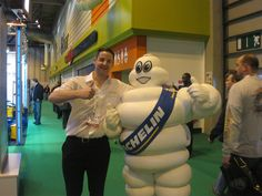 Me and the Michelin Man at automotive trade show. Btw, the Michelin Man is the one on the right. Michelin Man, Trade Show