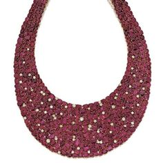 Ruby and diamond bib necklace, Michele della Valle. photo Sotheby's. Set with fancy-shaped rubies and round diamonds, mounted in 18 karat gold.