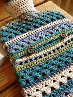 Love the mix of stitches -- Ravelry: Mixed Stitch Crocheted Hot Water Bottle Cover pattern by Sofie Kay