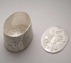 Silver vessels with leaf motifs by Melbourne-based jeweler Marian Hosking