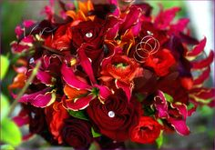 Beatiful, black magic roses, gloriosa lilies and orange ranunculu smade for a Queen