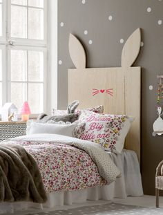 pay attention to the pokka dotted walls, rabbit headboard and floral bedsheets- pretty for a girl who loves nature and bunnies...