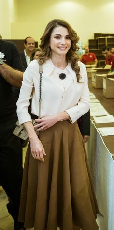 14 June 2016 - Queen Rania visits programs run by Caritas Jordan in Jabal Al Weibdeh - top by Balenciaga