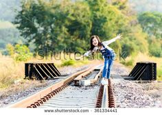Young asian Thai girl, walking on the railway on the forest background