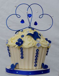 royal blue wedding cup cake. This is super cute! Instead of having a small wedding cake at the top of the cupcake tower, have a giant cupcake instead. Genius!