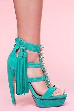 Pop of colored suede, fun fringe, tough metal studs, and flirty cut outs.  Swoon...