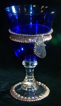 blue glass chalice -- with handcrafted copper beading and a large piece of clear rutilated quartz.