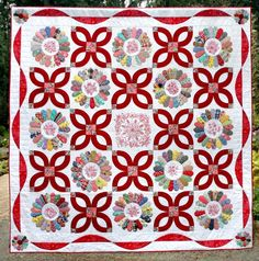 """Dresden Delight"":  2013 raffle quilt Westside Quilters Guild (Oregon).  Made with vintage hand piecedDresden plate blocks, redwork, and wedding ring arcs. Designed by guild member Jean Gorden."