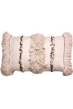 Blush Moroccan Handira Pillow. This pastel pink vintage textile was handwoven in Morocco. Each wedding blanket is one-of-a-kind with a storied history. It adorned the shoulders of a bride on her wedding day, keeping her warm during her journey to her husband. The sequins are said to glisten in the moonlit sky as she travels through the Atlas mountains. In true Berber tradition, it is believed that the handira brings blessings and good fortune.