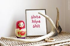 """""""sluta köpa skit"""" (stop buying shit) by Alicia Sivertsson, 2014. Cross stitch embroidery with thrifted fabric and yarn. ~18 x 13 cm (frame included)."""