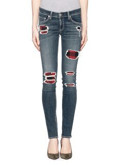This unique pair of rag & bone jeans features distressed details with a red and black tartan check underlay for a hint of rebellious nature. This pair imbues a sense of street-chic that will style well with anything from your casual wardrobe.