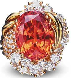 Padparadscha sapphire ring with diamonds in yellow gold