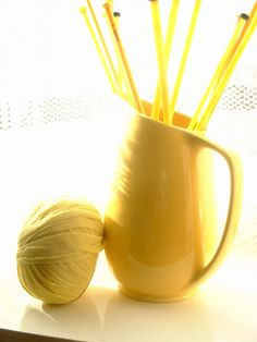 Jug/Pitcher containing Knitting Needles with a Ball of Yarn alongside . all in Yellow . Yellow Fever, Yellow Sun, Lemon Yellow, Shades Of Yellow, Golden Yellow, Mellow Yellow, Bright Yellow, Green And Orange, Colour Yellow