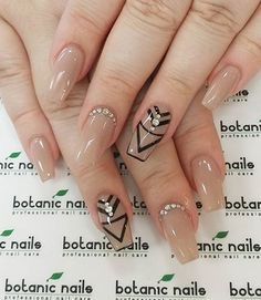 Sophisticated looking nude nail art design with geometrical shapes. Using two shades of nude nail polish and black is enough to make this design a true stand out. Don't forget to add simple embellishments on top to highlight the details.
