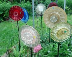 red, blue, peach, yellow, gold and clear glass garden ornaments.