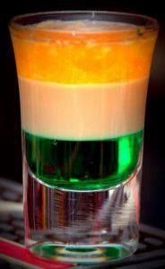 "An Irish Flag Drink  made with Creme de menthe, Baileys and Hennessy  Ingredients 1 oz. Green creme de menthe 1 oz. Baileys Irish Creme 1 oz. Hennessy or Irish whiskey Jamesons Directions  Mix ingredient in tall shooter Be sure and pour the "" heavier "" liquids first over the back of a spoon to get the look shown in the picture  Serve in a Tall shot glass"