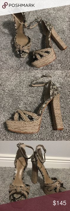 Schutz Kenedy platform sandals This snake printed SCHUTZ sandal is destined to be in your collection with it's woven 5 1/2 inch heel and 1 1/2 inch platform. Adjustable ankle strap. Covered heel and platform. Leather sole. Made In Brazil. SCHUTZ Shoes Heels