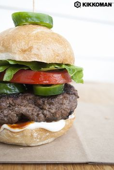 3 Ingredient Burger Patties | Why buy burgers at the store when they're this easy to make at home? Beef, Kikkoman®️ Soy Sauce, and Sriracha Hot Chili Sauce is all you need to pull these babies together. This recipe serves 4, or you could make smaller patties to serve as game day sliders! Serve your burgers on crusty buns with Kikkoman®️ Sriracha Mayo, tomato slices, lettuce, and a few slices of jalapeño. | #Kikkoman #easyrecipes #easydinner #quickandeasy #Sriracha #grilling