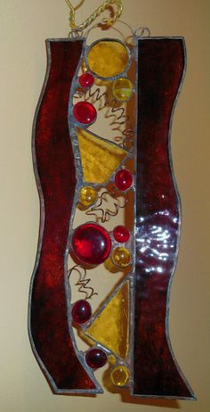 A vertical panel in the warm colors of red by MooreBeachGlass,