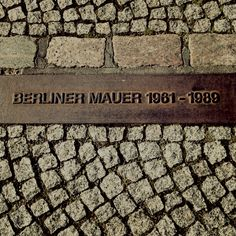 Berliner Mauer.  The Berlin Wall is outlined throughout the whole city with brick and this sign.