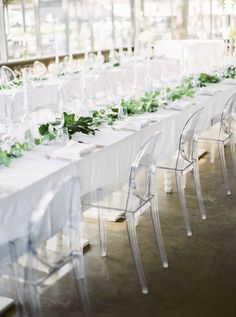 Relaxed, Elegant Thailand Destination Wedding white table linens paired with leafy green centrepiece garland on long dining tables paired with clear acrylic ghost chairs Green Centerpieces, Greenery Centerpiece, Modern Minimalist Wedding, Minimalist Wedding Dresses, Wedding Reception Chairs, Wedding Table, Wedding Ideas, Reception Ideas, Ghost Chair Wedding