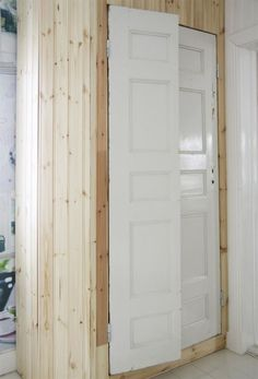 Closet doors made from one old door split into two doors. Diy Sliding Door, Diy Door, Built In Storage, Tall Cabinet Storage, Red Cottage, White Shelves, White Doors, White Paneling, Closet Designs