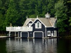 This boathouse needs an Address LED welcome home sign ... connected to the marine garage door.