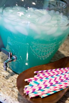 Disney Frozen Party Punch - Ingredients: 1 can lemonade concentrate, thawed 2 can-fulls of water 1 2-liters of lemon-lime soda 3 squirts Icee Zero Blue Raspberry Liquid Water Enhancer Ice
