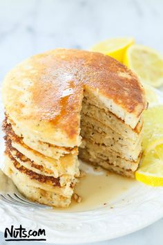 Lemon Poppy Seed Pancakes {Gluten-Free} - This recipe calls for brown rice flour and coconut flour, and is complete with the citrus flavor of lemon and crunchy poppy seeds. #glutenfree #pancakes #recipe