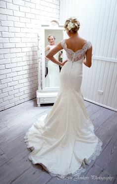This Stylish Figure Hugging Lace Wedding Gown Cant Help But Draw Attention The Drop V Neckline And Barely There Ca