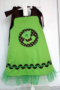 St. Patricks Day dress    Reverse side of Tana TuTu dress is ready for St. Patricks day! Green pique fabric is by Fabric Finders.Hat applique is from www.appliqueforki...  Materials to make this dress are available from www.sewblessedfab...