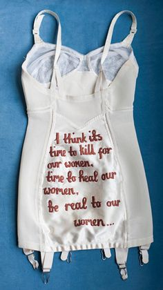 Vintage lingerie embroidered with Biggie and Tupac lyrics