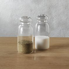 Shop 2-piece grill glass salt and pepper set.   Classic salt and pepper shakers get a modern makeover in crystal clear class.  Handmade and ready to serve, seasoners sit sophisticated on the table or countertop––too pretty to put away.