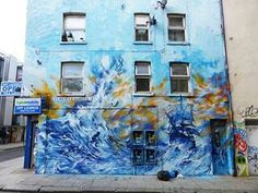 Street art By Jim Vision at Turville Street, London, England.