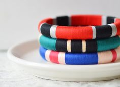Set of 3 Thread Wrapped Bangle Bracelets - Jewel Tone by The Glossy Queen available at Withal now. Silk Thread Bangles Design, Silk Bangles, Silk Thread Earrings, Thread Jewellery, Jewel Tone Colors, Jewel Tones, Bangles Making, Ornaments Design, Jewelry Patterns