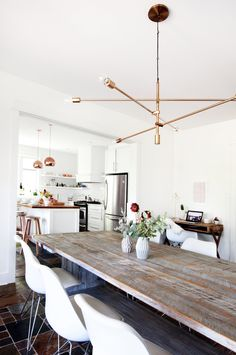 The dining table was custom made, while the dining chairs, desk and desk chair are from Maison Corbeil.