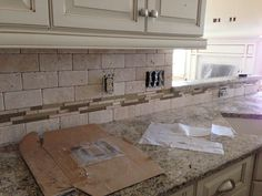 Tumbled Tile And Glass Backsplash