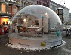 Cologne Furniture Fair idea: Make a snow globe display in your parking lot!