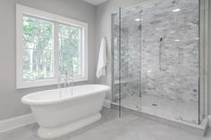 master shower with bench and 2 shower heads; next to stand alone tub