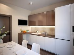 The kitchen and dining area are small but feel bigger than they are with use of a lot of white as well as diffused lighting that comes from overhead for a soft look throughout.
