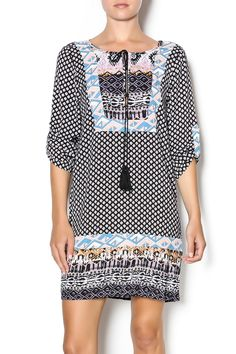 3/4 sleeve dress with different complimenting prints, black tassel detail, and adjustable sleeves.  This lightweight dress goes great with a pair of boots or sandals. Printed Sleeve Dress by The Wish Collection. Clothing - Dresses - Printed Clothing - Dresses - Casual Michigan