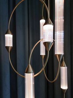 Shop suiteny.com for the Cirque suspension light by design duo, Giopato & Coombes. A geometric combination of brass thread-like structures and ribbed-glass light capsules, defined by its feeling of movement. Modern Sconces, Contemporary Floor Lamps, Modern Chandelier, Contemporary Design, Pendant Lighting, Pendant Lamps, Apartment Interior Design, Midcentury Modern, Room Makeovers